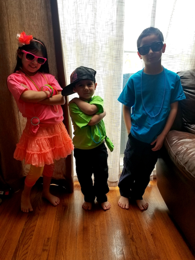 3 childrens dressed in their neon colors
