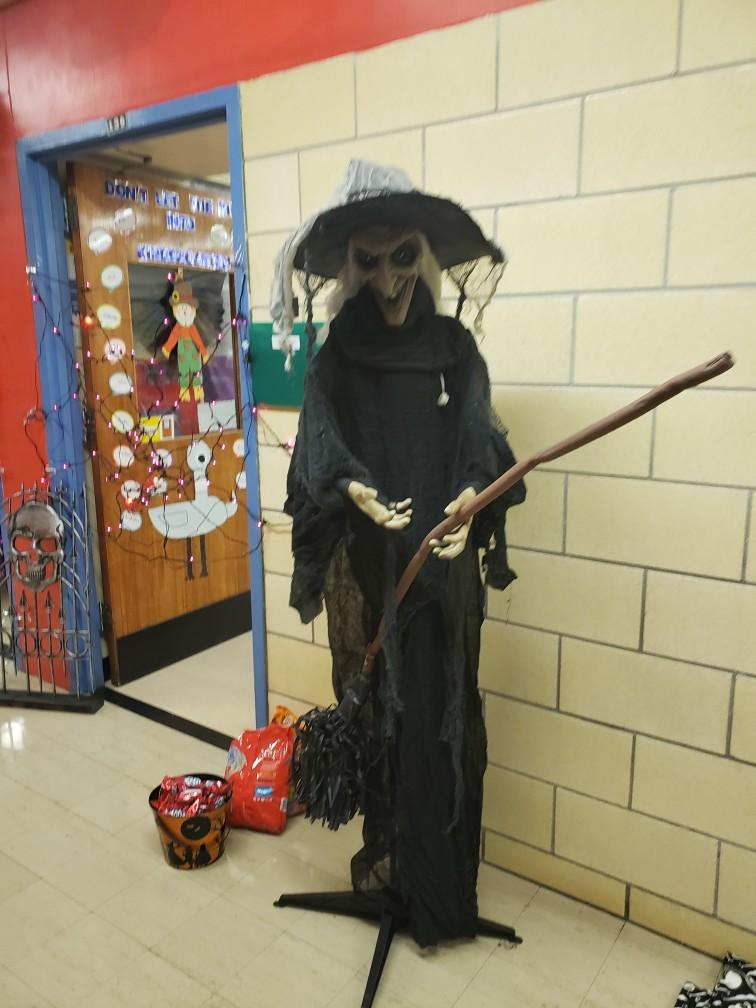 a witch decoration in front of a classroom