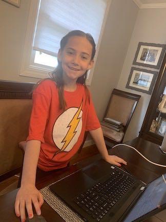 a girl wearing her super hero shirt