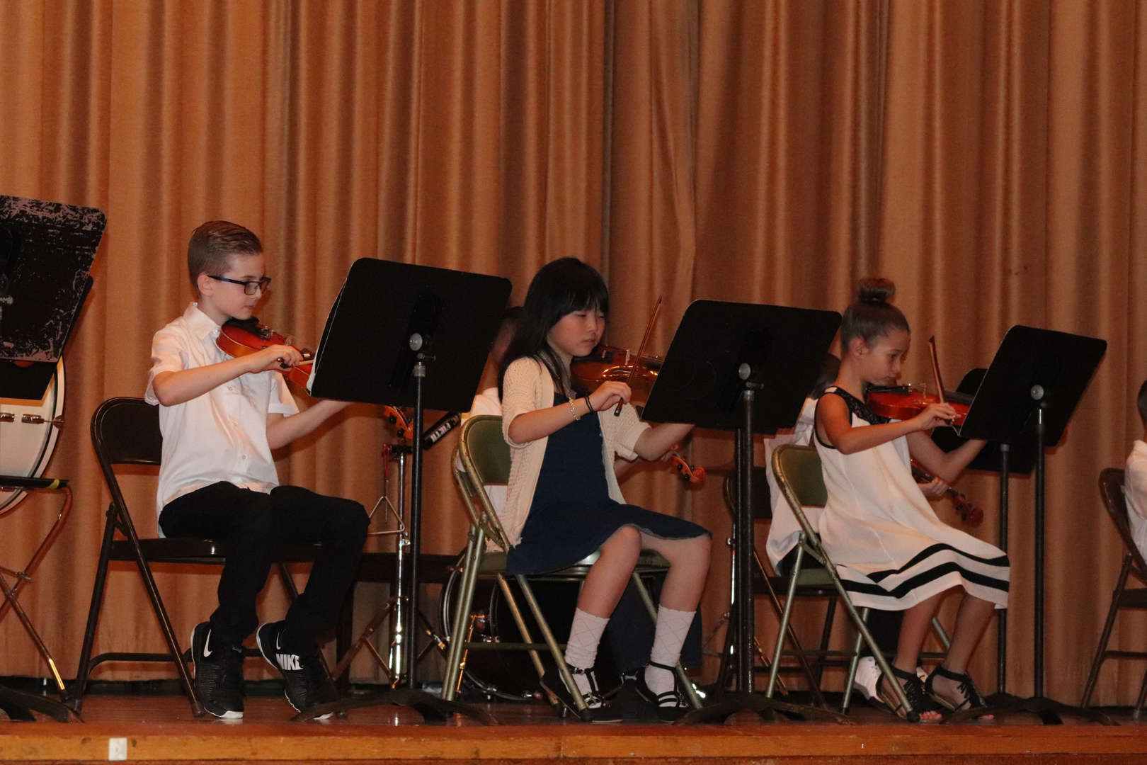 another group of violinists on stage