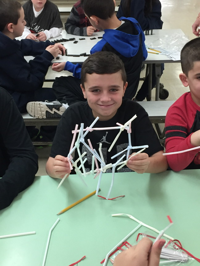 5th grader making a straw structure
