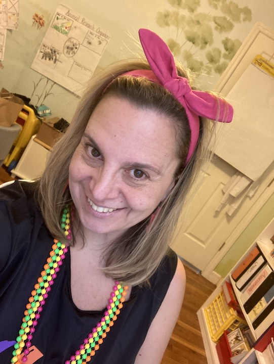 a teacher joining in the fun with her 80's costume