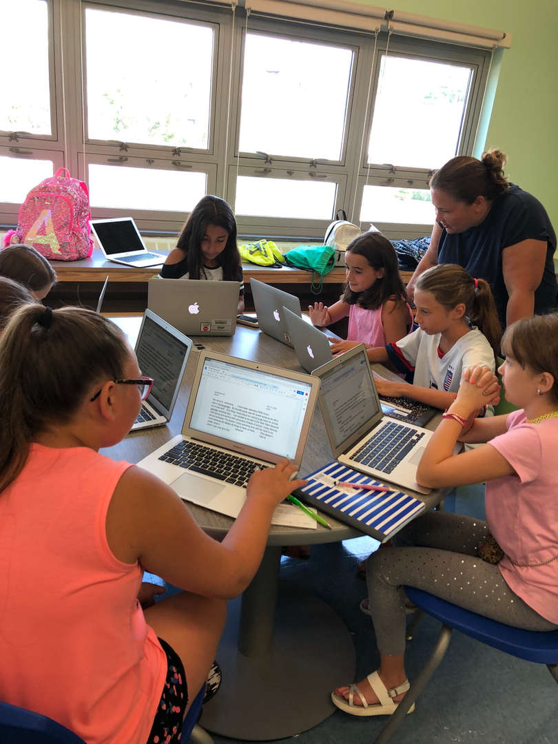 Mrs. Crabbe and students using computers
