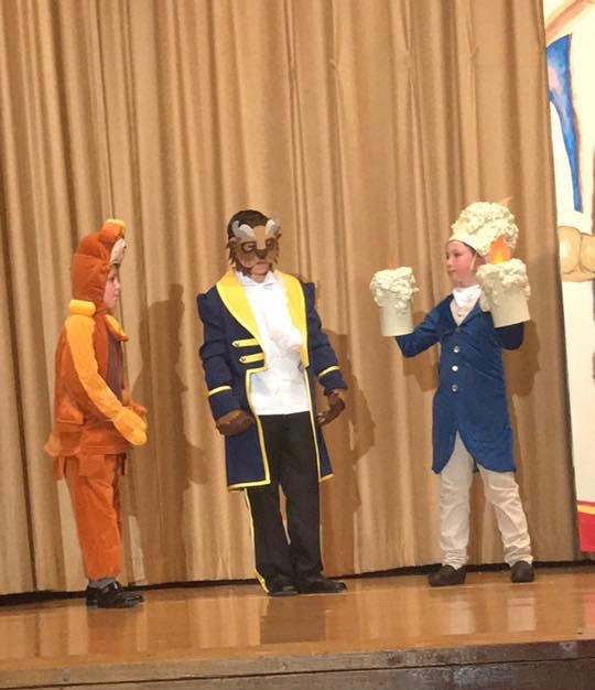 The beast is talking to Lumiere and another character
