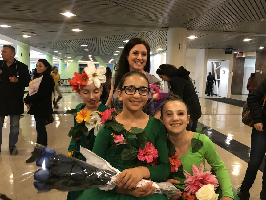 three smiling girls after the perfomance and Mrs. Clarke