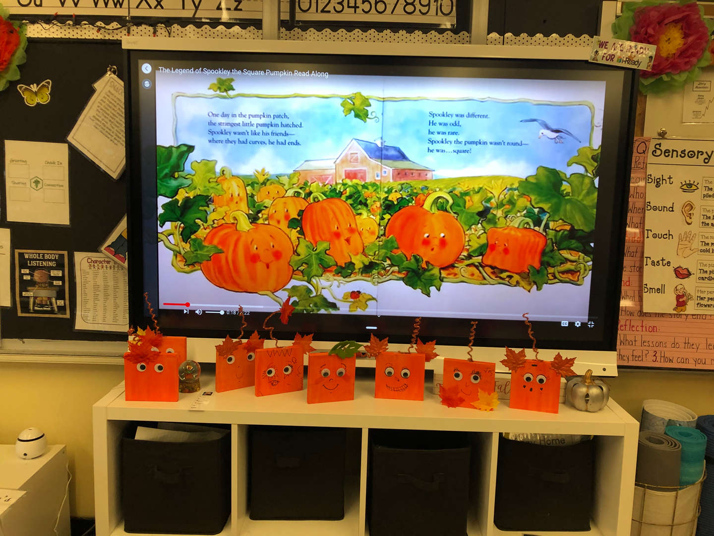a table displaying the student's Halloween art project
