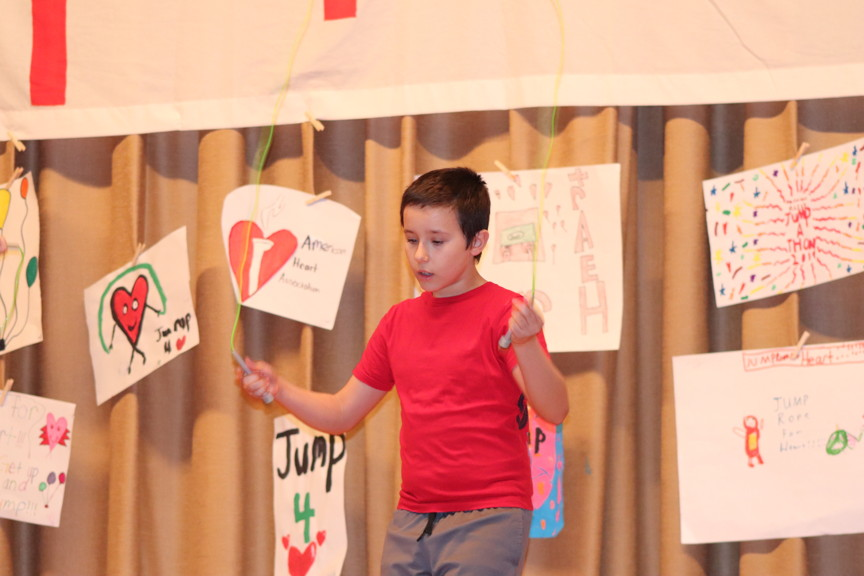 a student jumping his rope on stage