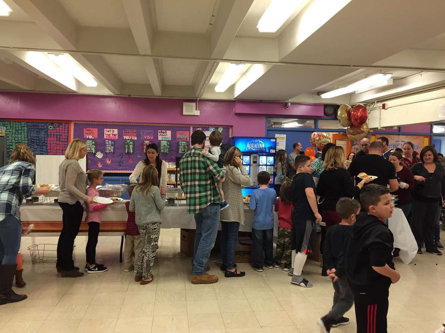 parents and children getting food