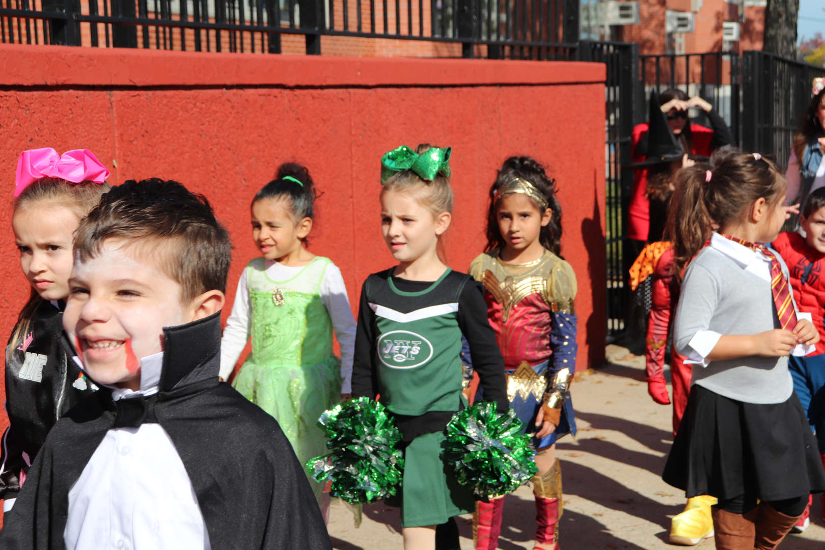 students moving along in costume