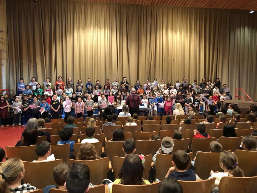 more third graders singing