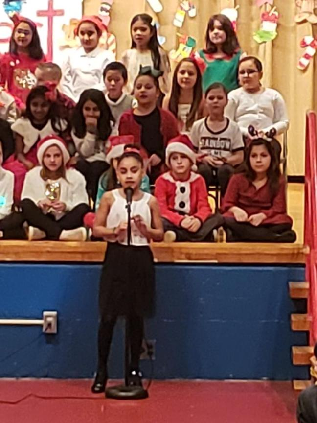a girl student singing a solo