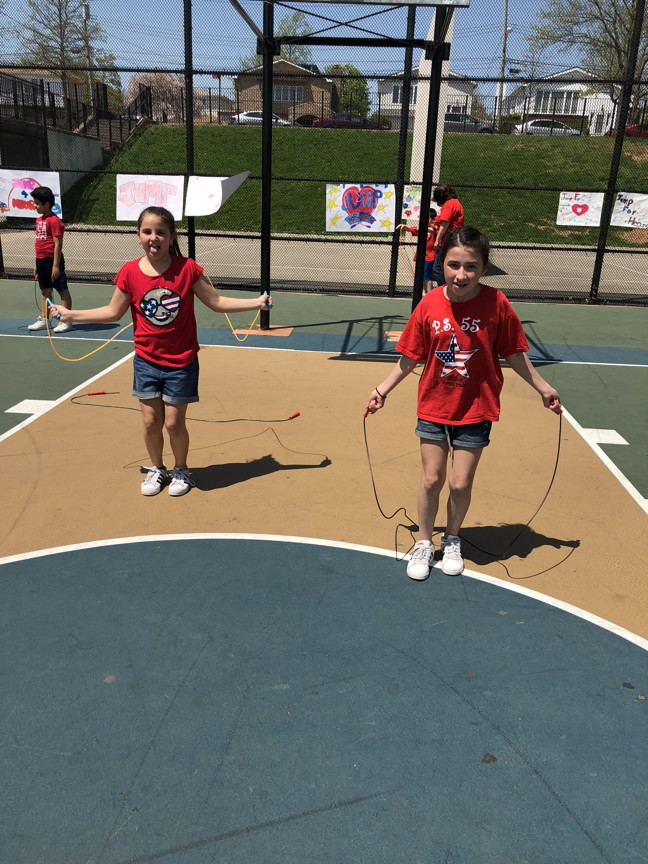 two girls getting ready to jump rope