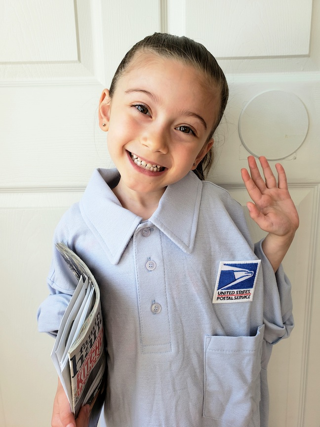 This girl is a smiling postal worker