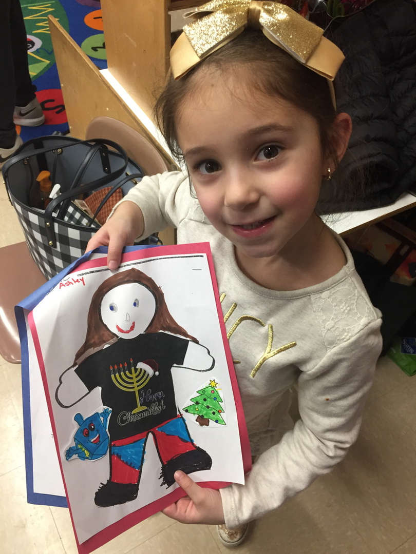 a girl showing her picture