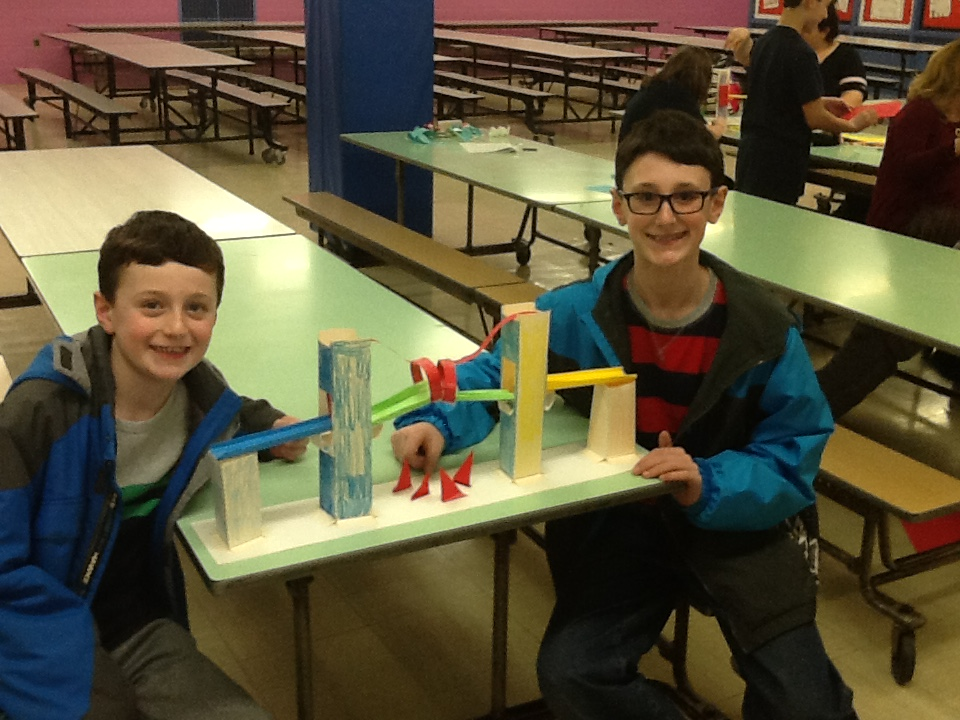 Two fifth graders showing their bridge