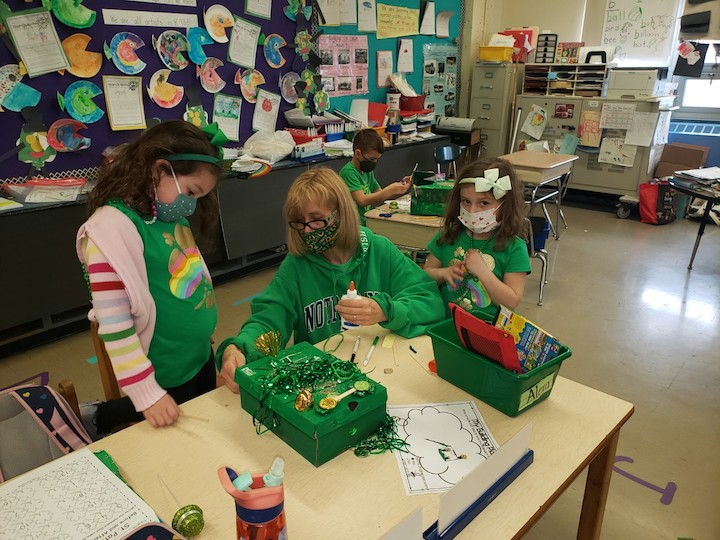 Working together to get the Leprechaun traps ready!