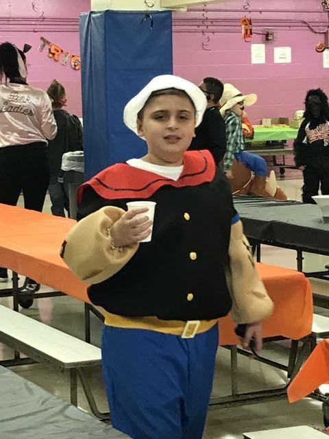 a boy dressed as Popeye