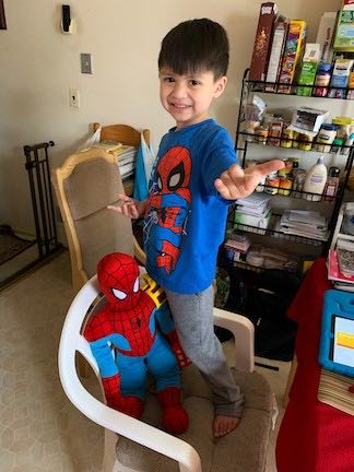 two boys wearing spiderman outfits