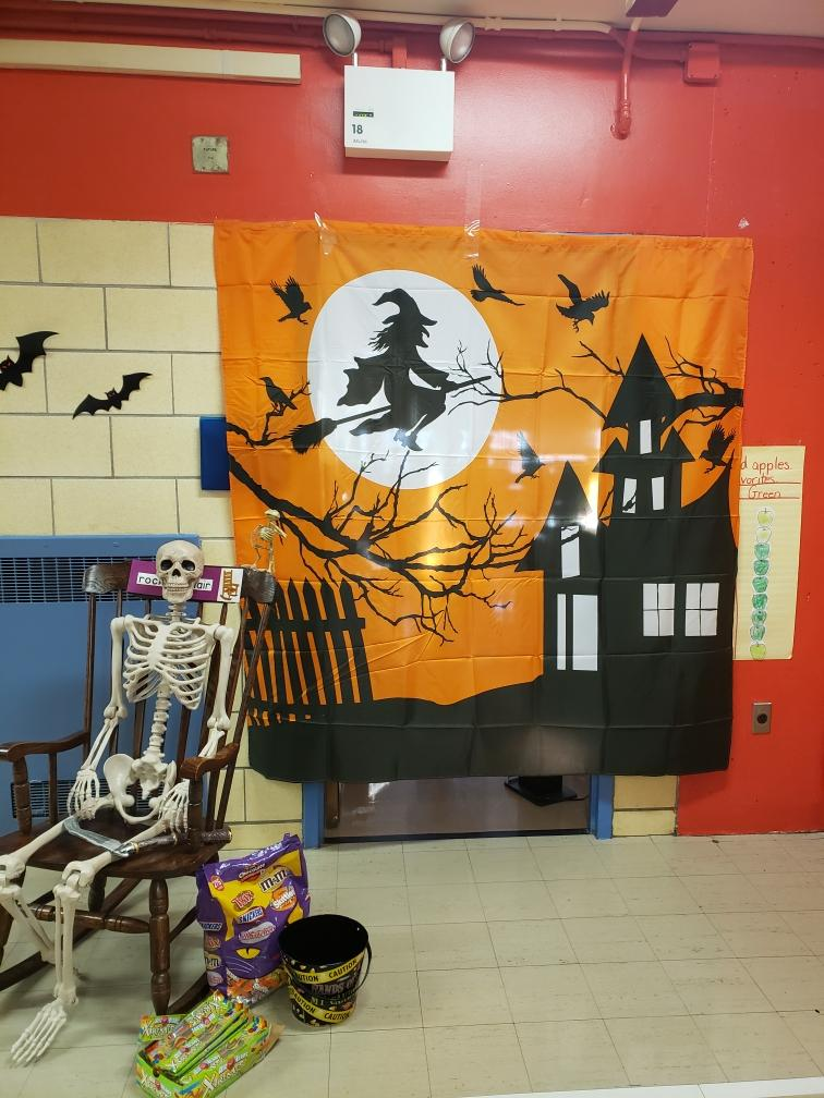 a Halloween image on the wall of the hall