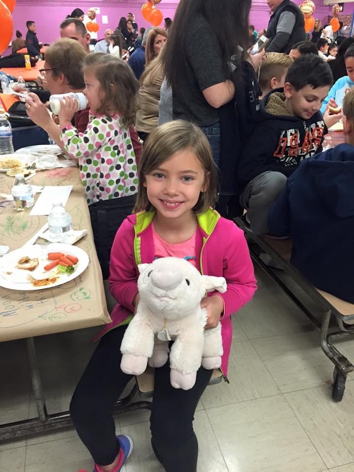 a student and her stuffed animal