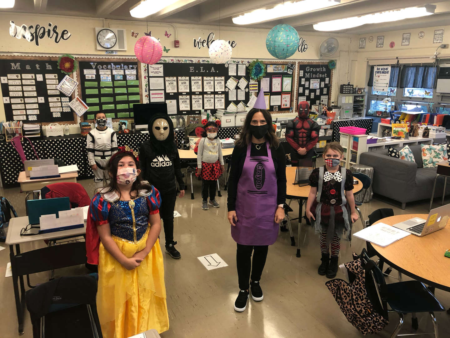 Class are wearing their costumes and posing 6feet apart