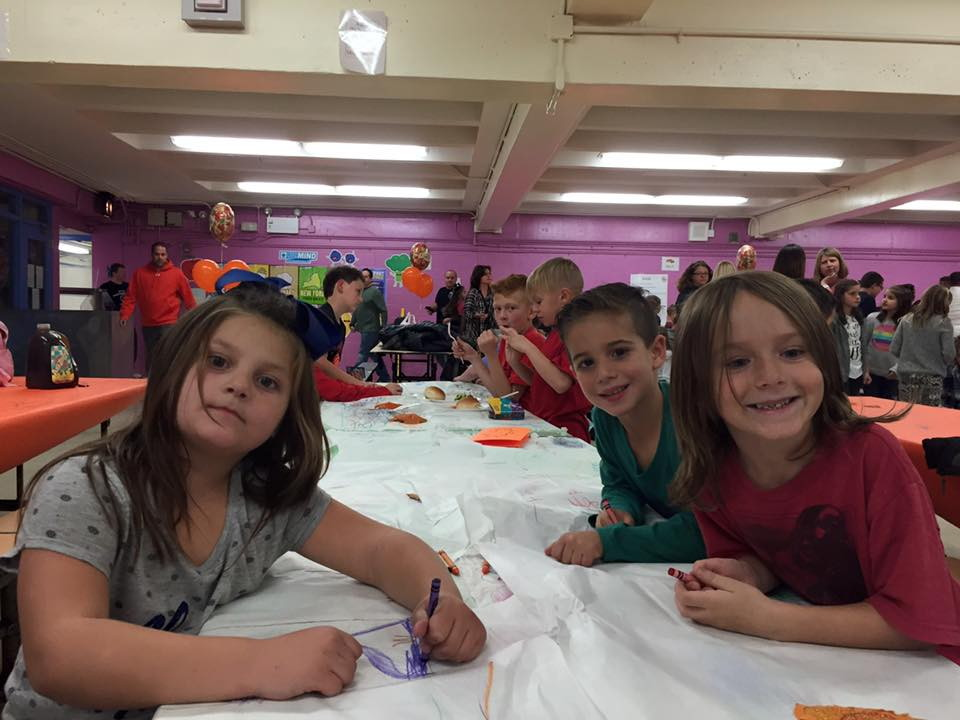 students coloring at a table