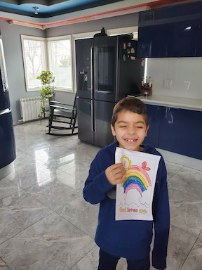 a boy holding up his rainbow