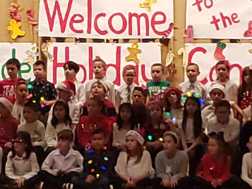 some 3rd grade students singing