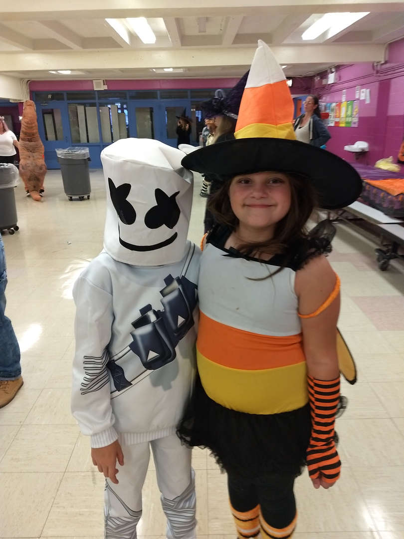 a boy and a girl in costume