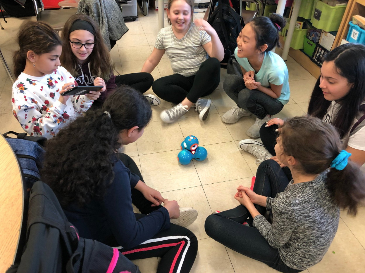 a large group of girls programming Dash