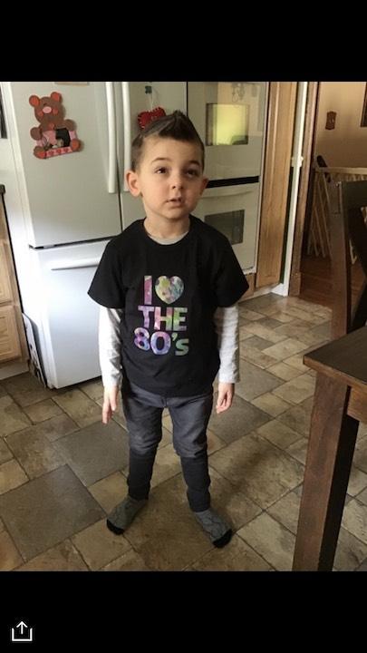 his tee shirt says I love the 80's