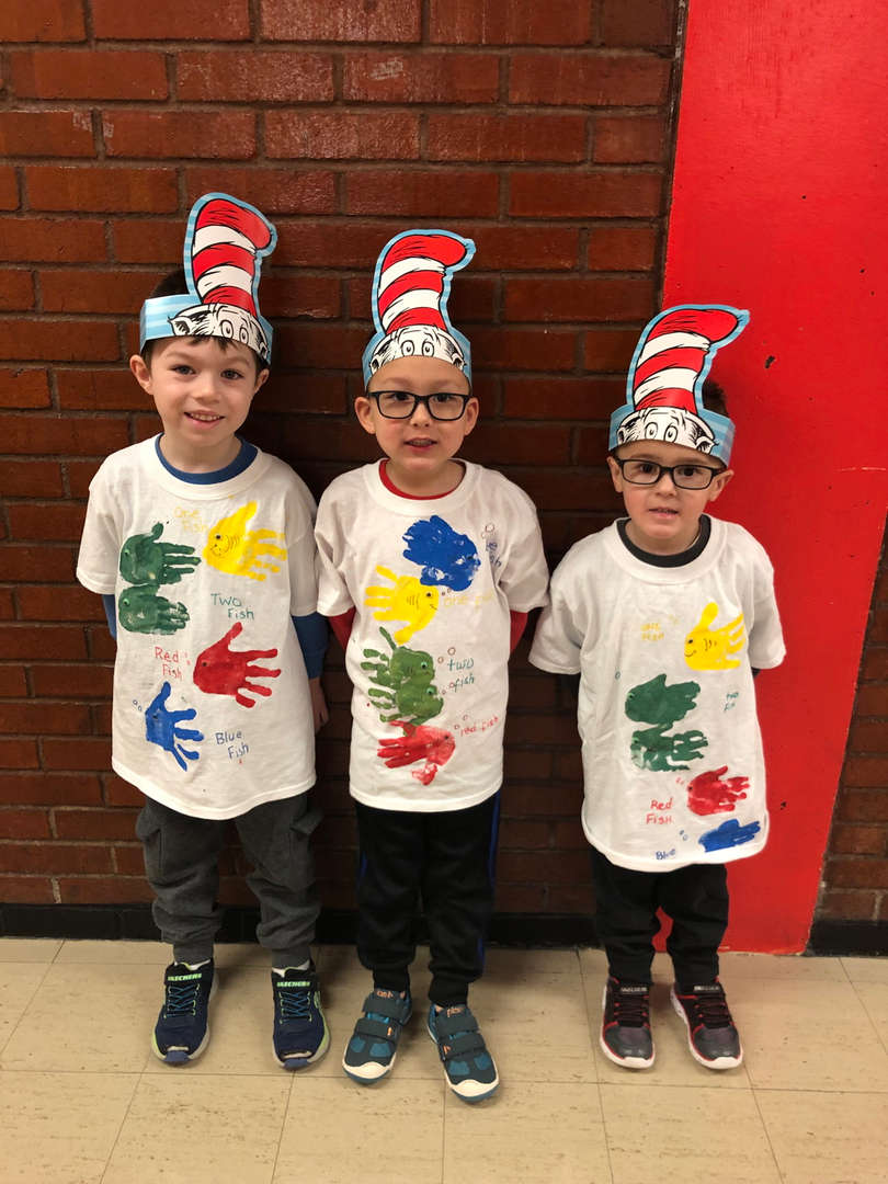 three boys wearing Cat in the Hat hats