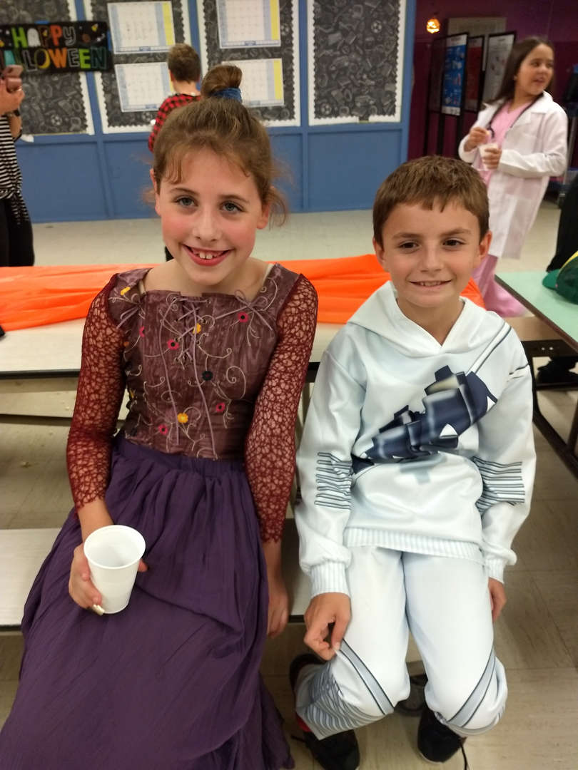 a boy and girl student in costume