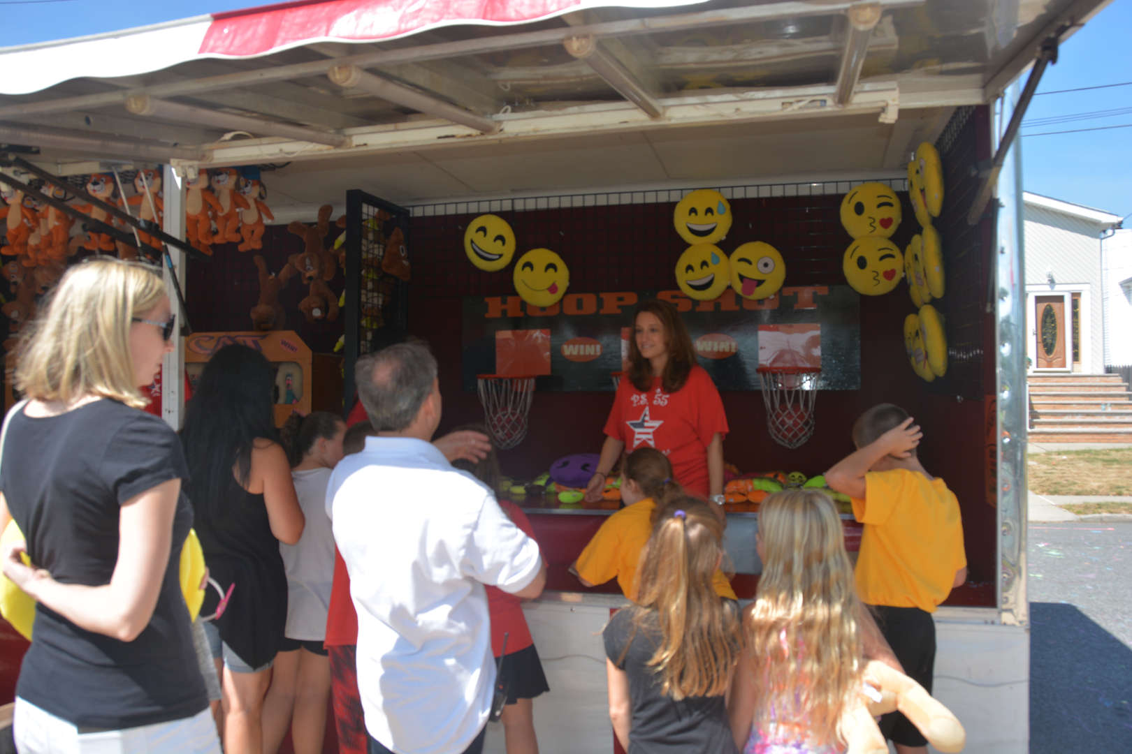 Mrs. Saccommano in a game booth