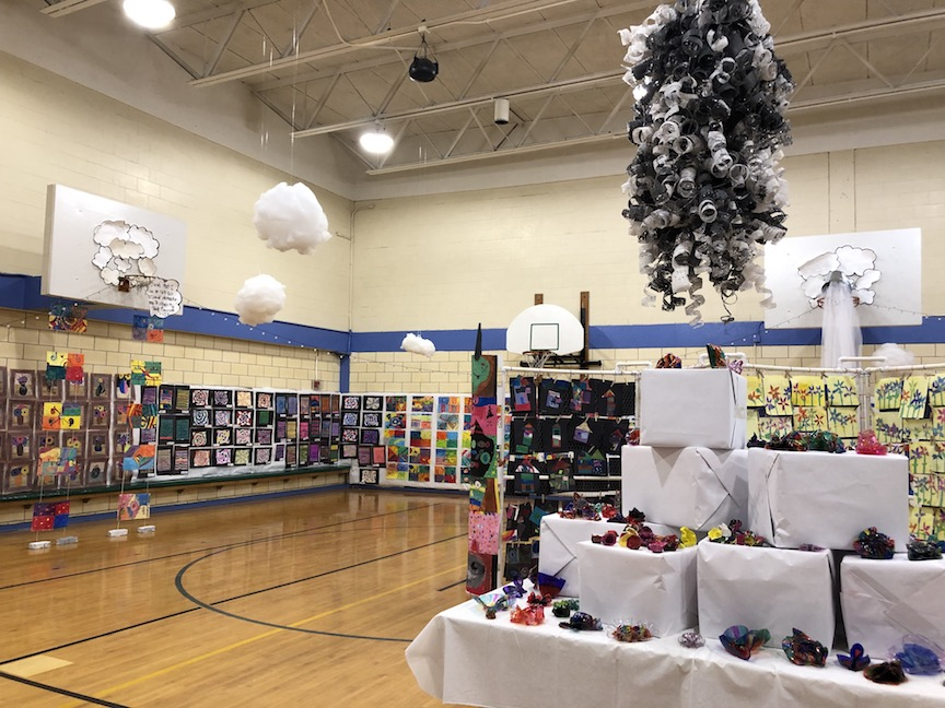 a view of one side of the gym showing the artwork