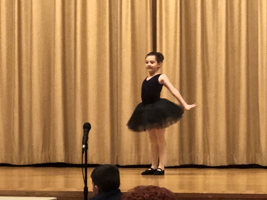 a ballerina ready to perform