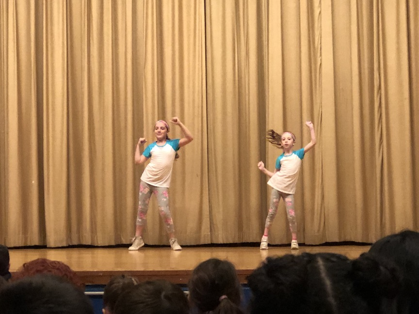 two girls dressed alike dancing