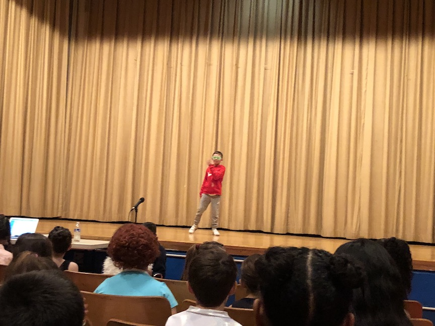 a boy in a red top ready to perform