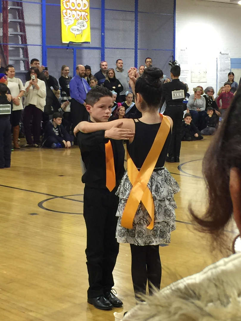 a couple prepared to begin dancing