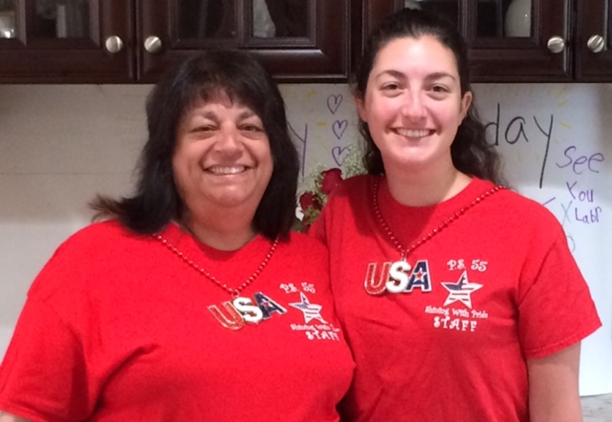 This is a mother and daughter in red tees with an American flag star