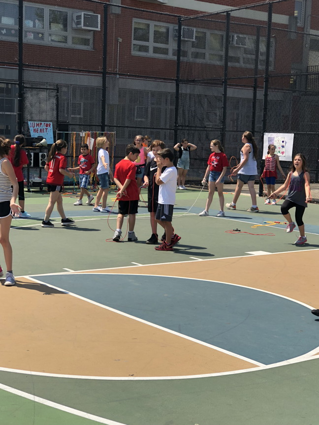 students in yard getting ready to jump rope