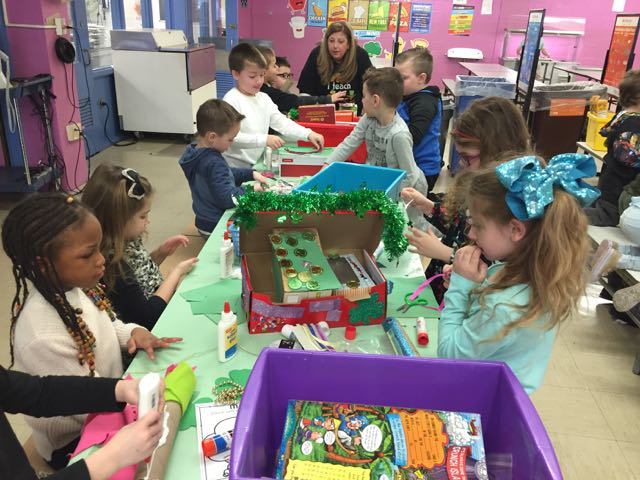 a view of a table of children hard at work