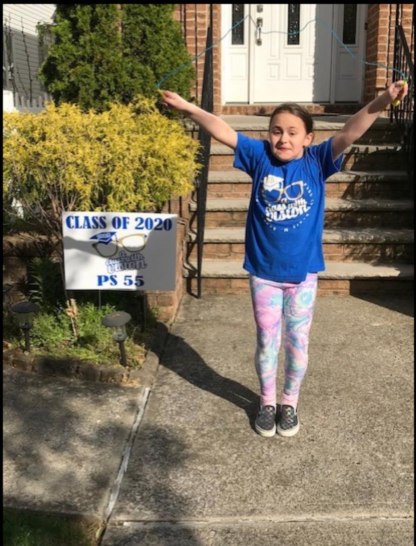 This girl is wearing her blue school tee