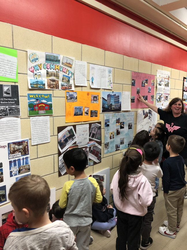 students in the hall admiring the projects