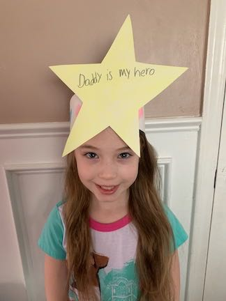 this young lady has a star on her head that says her daddy is her superhero