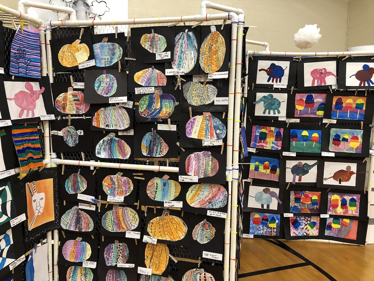 pictures on different shaped paper and elephant pictures in the background.