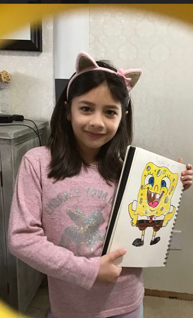 a girl with her picture of Spong Bob