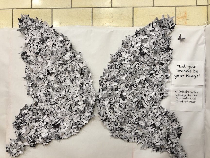 a huge butterfly made of papers telling students dreams