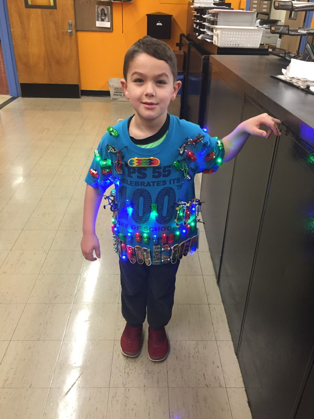 a student  wearing a lit 100th day t-shirt