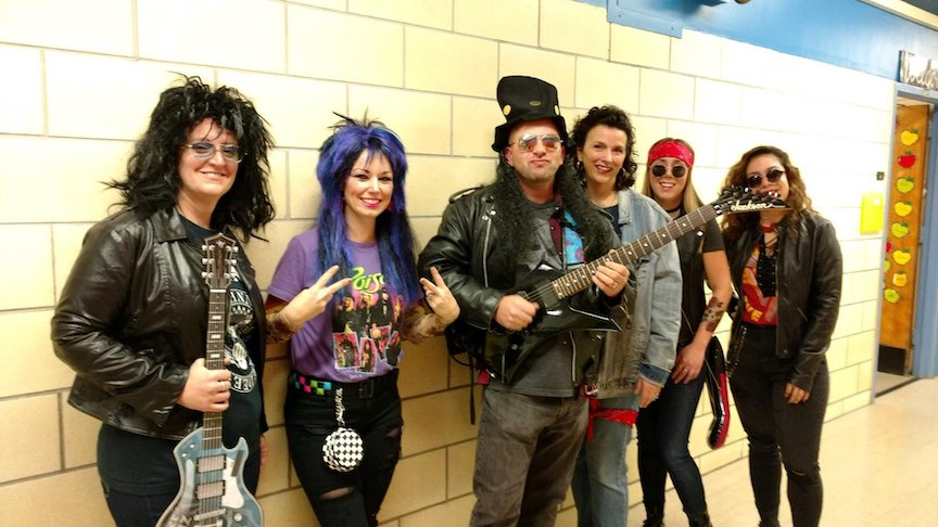 these teachers are dressed like rock and rollers